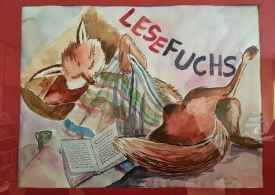 Gemaltes Bild des Lesefuchs-Maskottchens